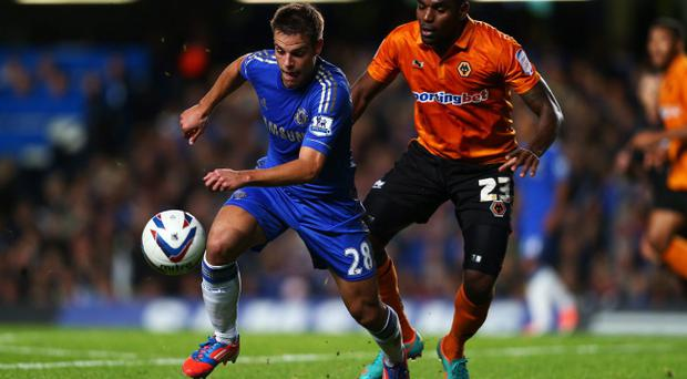 LONDON, ENGLAND - SEPTEMBER 25: Chelsea's Cesar Azpilicueta and Wolverhampton Wanderers' Ronald Zubar compete for the ball during the Capital One Cup third round match between Chelsea and Wolverhampton Wanderers at Stamford Bridge on September 25, 2012 in London, England. (Photo by Clive Rose/Getty Images)