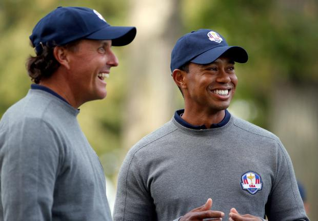 MEDINAH, IL - SEPTEMBER 25: Tiger Woods and Phil Mickelson of the USA share a joke during the second preview day of The 39th Ryder Cup at Medinah Country Golf Club on September 25, 2012 in Medinah, Illinois. (Photo by Jamie Squire/Getty Images)