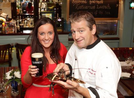 Derek Patterson, owner of the Plough Inn, and Gemma Bell, corporate relations at Diageo NI, at the |official opening of Seafood Gourmet restaurant