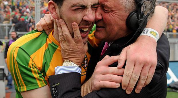Moving moment: Mark McHugh and dad Martin's emotional embrace
