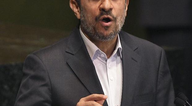 Mahmoud Ahmadinejad speaks at the United Nations General Assembly (AP/Seth Wenig)