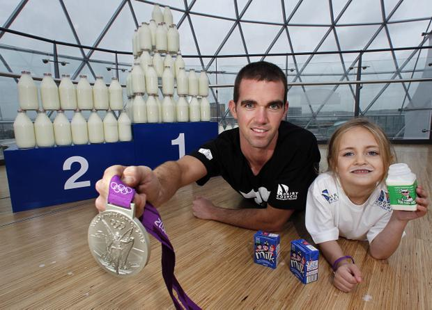 Olympic medallist Richard Chambers and Molly Clarke from Elmgrove PS celebrate the importance of milk for children on World School Milk Day