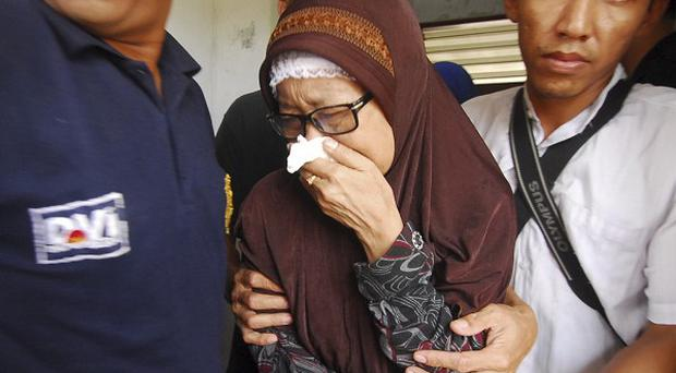 An Indonesian woman whose daughter died in the ferry accident weeps at a hospital in Cilegon, Banten province (AP)