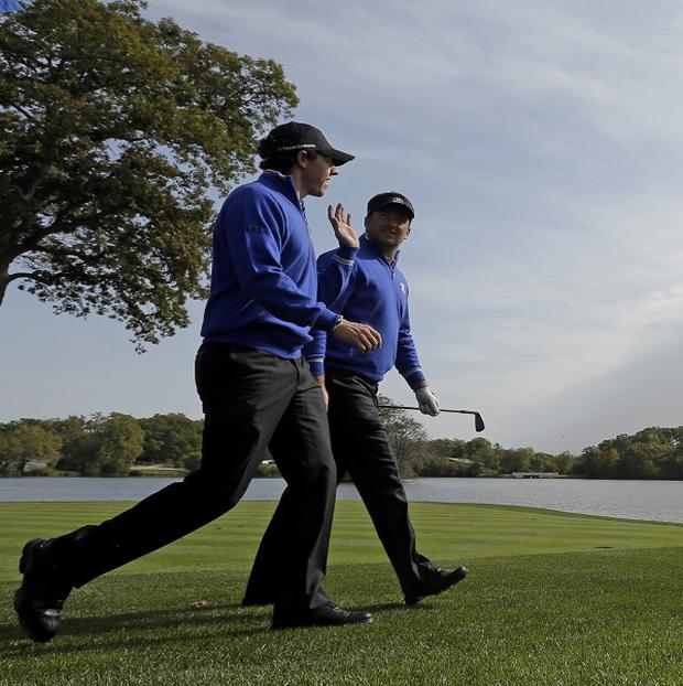 Rory McIlroy, left, is focusing on the whole team at the Ryder Cup (AP)