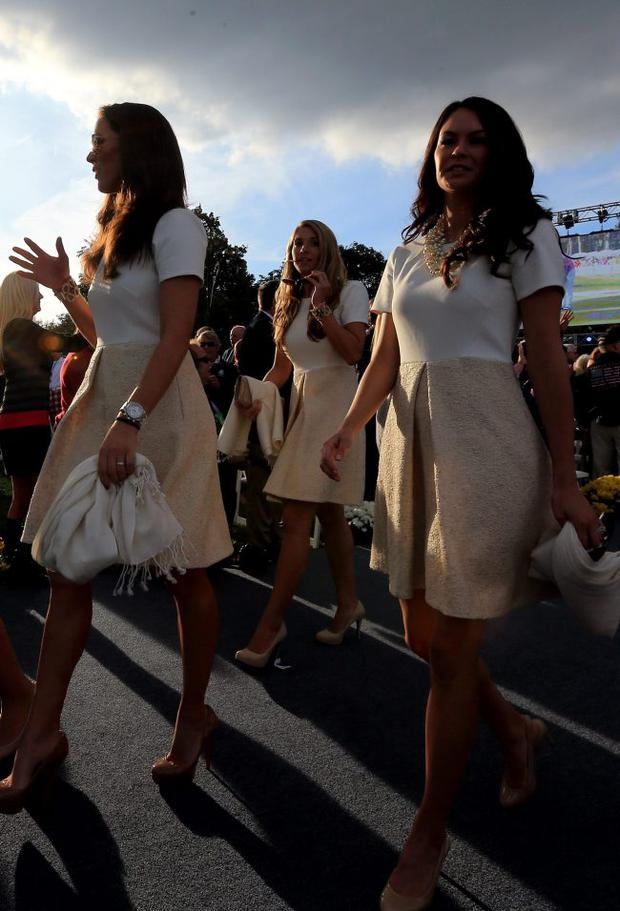 USA team players wives walk in during the Opening Ceremony for the 39th Ryder Cup at Medinah Country Club on September 27, 2012 in Medinah, Illinois.