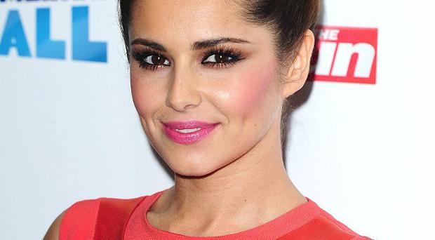 Cheryl Cole will reportedly perfrom her new song on Strictly