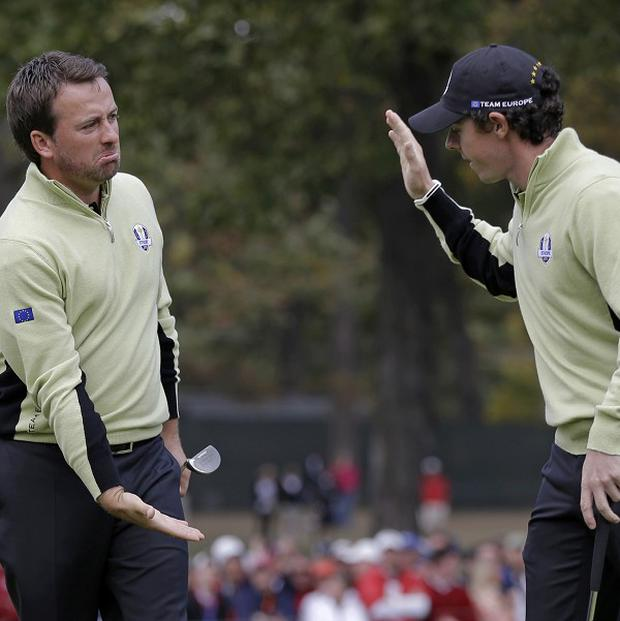 Europe's Graeme McDowell, left, is congratulated by Rory McIlroy after making a putt (AP)