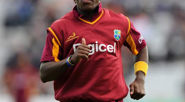 Fidel Edwards claimed West Indies' first wicket but rain scuppered any chance of a result
