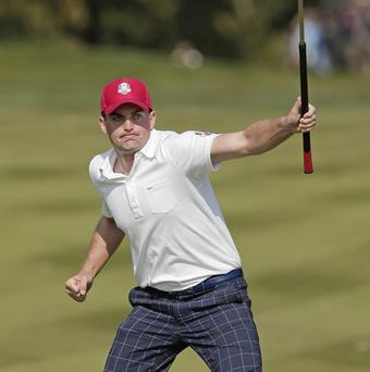 USA's Keegan Bradley reacts after making a birdie putt on the eighth hole (AP)