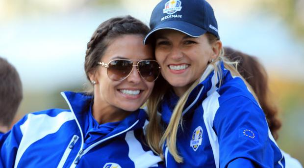 MEDINAH, IL - SEPTEMBER 28: Kristin Stape and Kate Rose look on during the Afternoon Four-Ball Matches for The 39th Ryder Cup at Medinah Country Club on September 28, 2012 in Medinah, Illinois. (Photo by David Cannon/Getty Images)