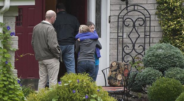 Visitors arrive at the home of Jeffrey Giuliano in New Fairfield, Connecticut (AP)