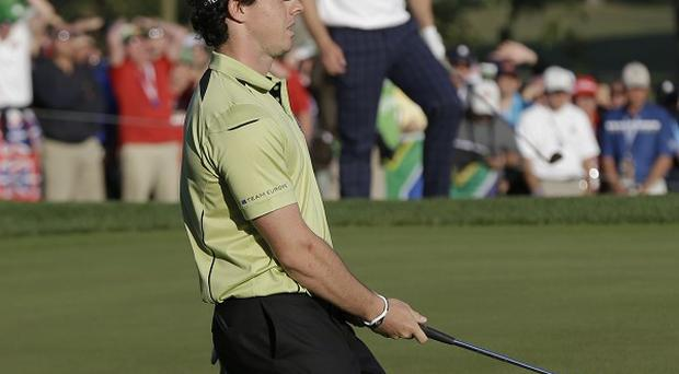 Europe's Rory McIlroy reacts after missing a birdie putt on the 16th hole (AP)