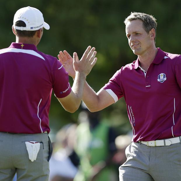 Luke Donald, right, and Sergio Garcia hold the advantage over Tiger Woods and Steve Stricker (AP)