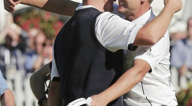 Ian Poulter, right, congratulates Justin Rose after Rose defeated USA's Phil Mickelson (AP)
