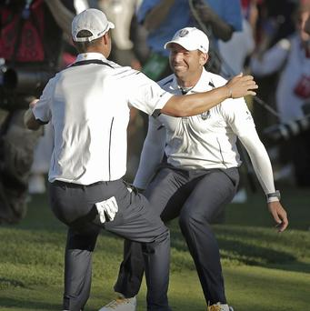 Europe's Sergio Garcia and Martin Kaymer celebrate after winning the Ryder Cup (AP)