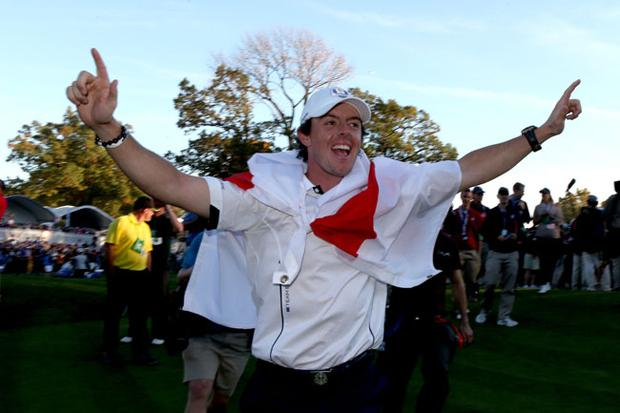 MEDINAH, IL - SEPTEMBER 30: Rory McIlroy celebrates after Europe defeated the USA 14.5 to 13.5 to retain the Ryder Cup during the Singles Matches for The 39th Ryder Cup at Medinah Country Club on September 30, 2012 in Medinah, Illinois. (Photo by Andrew Redington/Getty Images)
