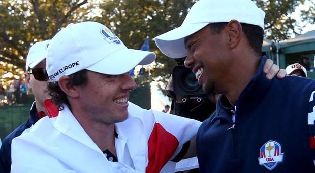 MEDINAH, IL - SEPTEMBER 30: Rory McIlroy of Europe (L) and Tiger Woods of the USA greet each other on the 18th green after Europe defeated the USA 14.5 to 13.5 to retain the Ryder Cup during the Singles Matches for The 39th Ryder Cup at Medinah Country Club on September 30, 2012 in Medinah, Illinois. (Photo by Mike Ehrmann/Getty Images)