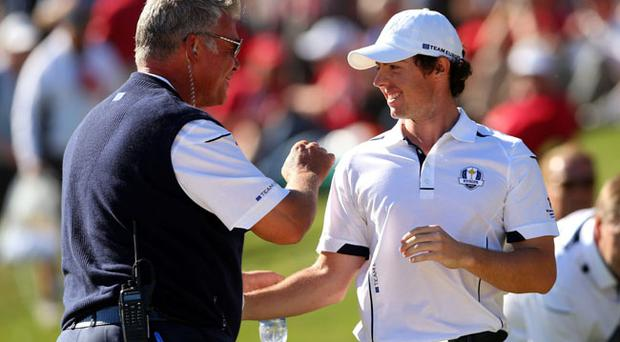 MEDINAH, IL - SEPTEMBER 30: Darren Clarke and Rory McIlroy during the Singles Matches for The 39th Ryder Cup at Medinah Country Club on September 30, 2012 in Medinah, Illinois. (Photo by Mike Ehrmann/Getty Images)