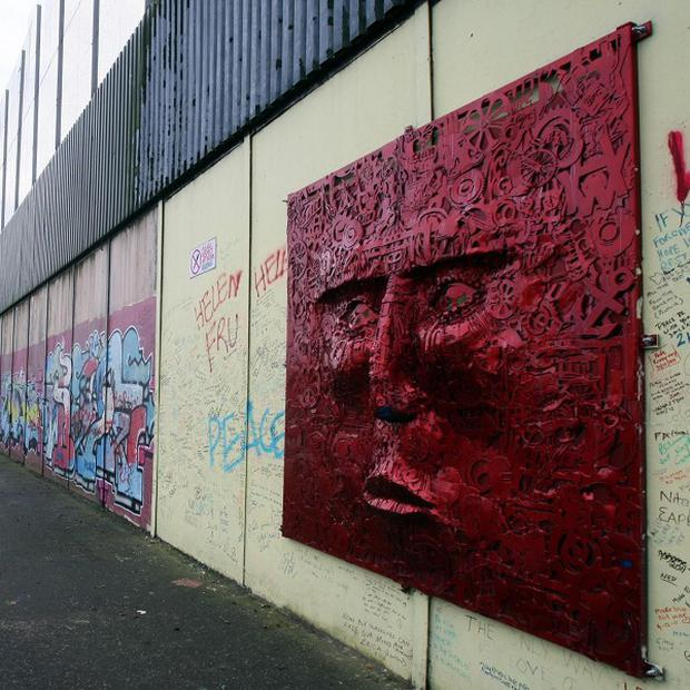 The largest peace wall in Belfast, at Cupar Way, which separates the Catholic Falls area and the Protestant Shankill area of the city