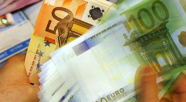 European Central Bank's two former chief economists said the central bank was overstepping its mandate