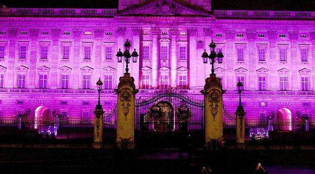 Buckingham Palace is bathed in pink light for the launch of Breast Cancer Campaign's action month