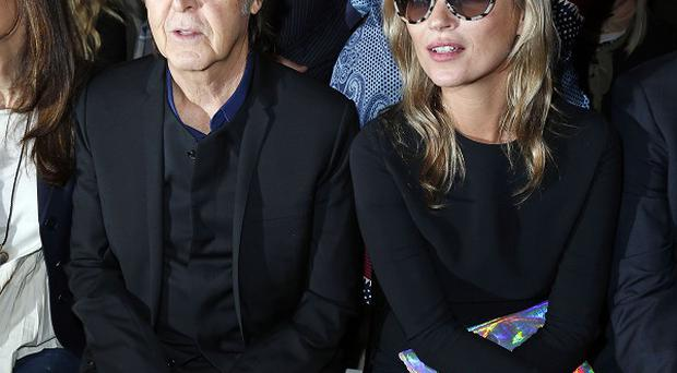 Sir Paul McCartney and model Kate Moss were on the front row at Stella McCartney's show in Paris