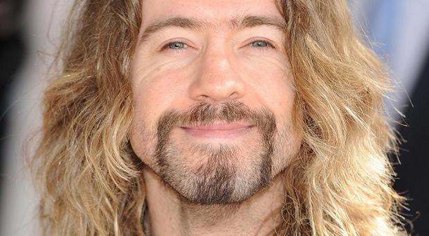 Justin Lee Collins' lawyer has accused his ex-girlfriend of trying to blackmail the TV star