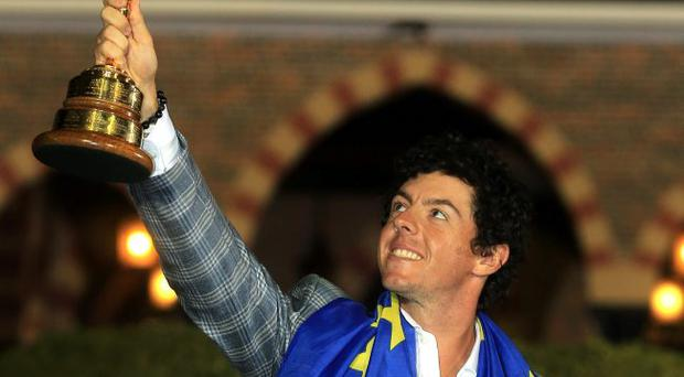 Rory McIlroy celebrates with the Ryder Cup after Europe performed a spectacular comeback to beat the USA