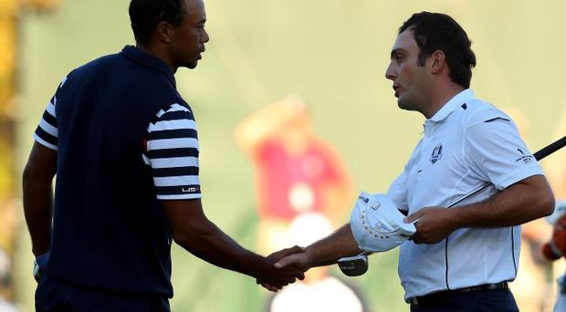 Shake on it: Tiger concedes a putt to Francesco Molinari on the 18th, leading to Europe winning outright