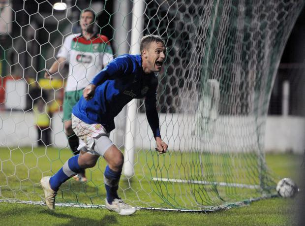 It's a knockout: Peter Thompson celebrates scoring Linfield's dramatic winner