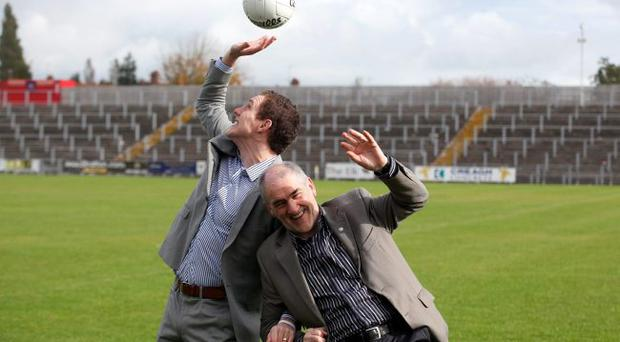John McAreavey and Mickey Harte competing for the ball at Casement Park as they announced details of an event in Michaela's honour