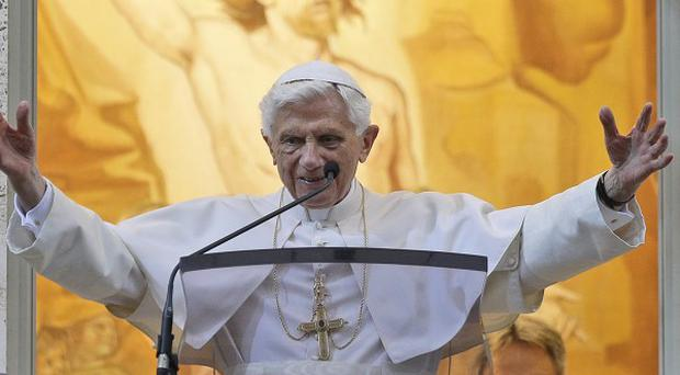 Pope Benedict XVI has returned to the Vatican in time for the trial of his former butler, who is accused of theft (AP)