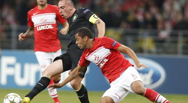 Spartak Moscow Rafael Carioca, right, fight for the ball with Celtic FC Gary Hooper during their Champions League Group G match in Moscow, Tuesday Oct. 2, 2012. (AP Photo/Sergey Ponomarev)