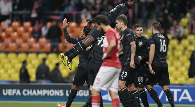Celtic players celebrate their goal against Spartak Moscow during the Champions League Group G soccer match at the Luzhniki stadium in Moscow, Russia, on Tuesday, Oct. 2, 2012. Celtic won 3-2. (AP Photo/Ivan Sekretarev)