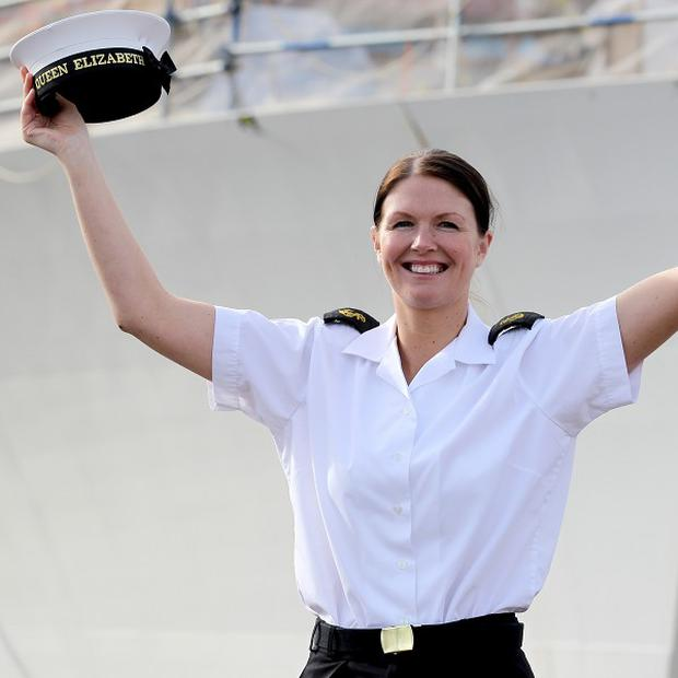 Royal Navy Leading Hand Claire Butler, the first crew member to board new aircraft carrier HMS Queen Elizabeth