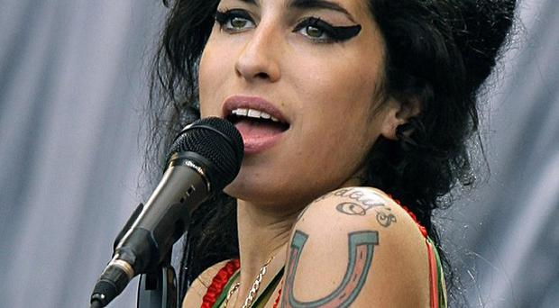 Amy Winehouse's backing singer Zalon wrote his song You Let Me Breathe after hearing of the pop star's death