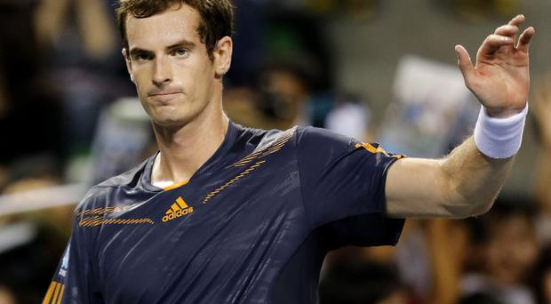Andy Murray of Britain celebrates his second round win over Lukas Lacko of Slovakia at the Japan Open tennis championships in Tokyo Wednesday, Oct. 3, 2012. (AP Photo/Shuji Kajiyama)