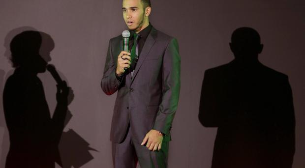 Formula One driver Lewis Hamilton talks during an event in Tokyo, Wednesday, Oct. 3, 2012. In his first race since confirmation he will leave McLaren to join Mercedes next season, Hamilton must get his focus back on track and the Formula One championship fight at this weekend's Japanese Grand Prix. (AP Photo/Shizuo Kambayashi)