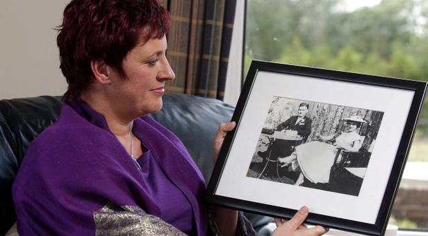 Northern Ireland- 12th September 2012 Mandatory Credit - Photo-Jonathan Porter/Presseye. Jenny Grainer pictured at her home outside The Temple in Co. Down hold a picture of her mother Barbara. The collect picture is of her father Michael and mother Barbara on their wedding day in the mid 1950s.