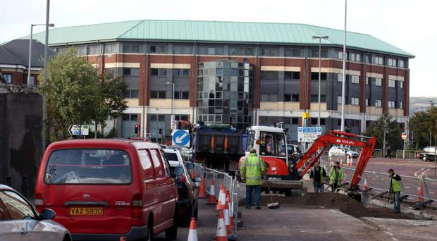 Cars are being forced to use one lane because of roadworks at Millfield in Belfast city centre for a second week