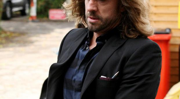 Justin Lee Collins is accused of slapping and harassing his ex-girlfriend Anna Larke