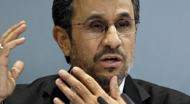 Iranian president Mahmoud Ahmadinejad blames the drop in currency value on the West (AP)