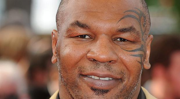 Former boxer Mike Tyson has been banned from entering New Zealand (AP)