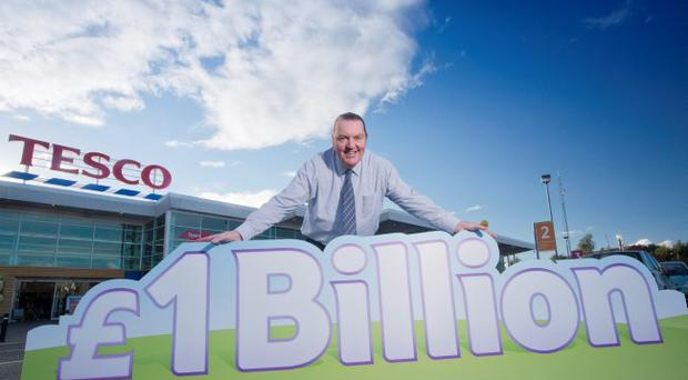 Tesco commercial manager Cliff Kells marks its commitment to buying £1bn worth of Northern Ireland food and drink from the province's suppliers, growers and producers over the next two years