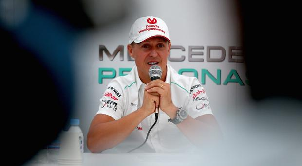 SUZUKA, JAPAN - OCTOBER 04: Michael Schumacher of Germany and Mercedes GP announces his retirement at the end of the season during previews for the Japanese Formula One Grand Prix at the Suzuka Circuit on October 4, 2012 in Suzuka, Japan. (Photo by Clive Mason/Getty Images)