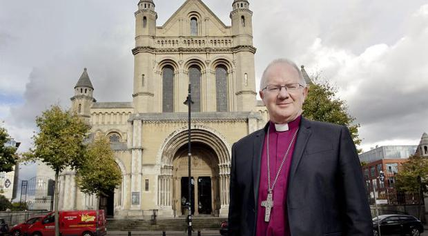 Appointment: Dr Richard Clarke outside St Anne's Cathedral in Belfast yesterday