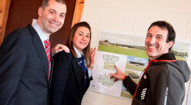 Looking over plans for the remodelled clubhouse at Ederney St Joseph's, are Nigel Walsh, Regional Director (Business Banking) for the Ulster Bank, Astrid O'Donnell, Ulster Bank Branch Manager, Enniskillen and Sean Donnelly, Chairman, Ederney St. Joseph's GAC.