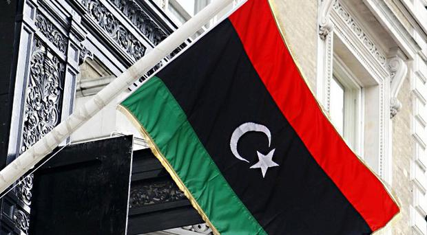 The flag of the Libyan Republic used by the National Transitional Council outside the Libyan Embassy in London