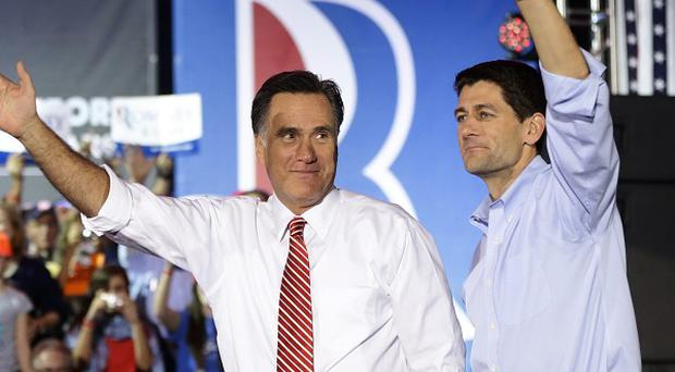 Mitt Romney campaigns with his running mate Paul Ryan in Virginia (AP)