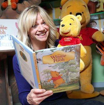Zoe Ball reads to children at the launch of the Winnie the Pooh Storytelling Academy